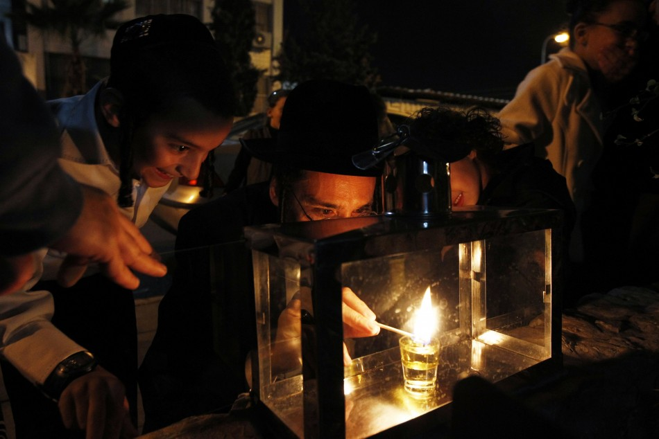Ultra-Orthodox Jews light a candle for Hanukkah in Ashdod