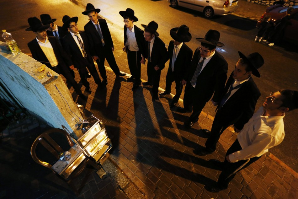 Ultra-Orthodox Jews dance after lighting candles for Hanukkah in Ashdod