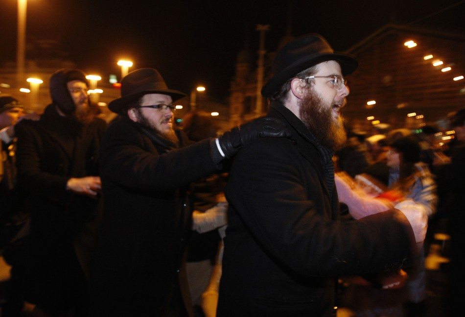 Members of Hungarys Jewish community gather to celebrate Hanukkah and to light the first candle on the menorah in downtown Budapest