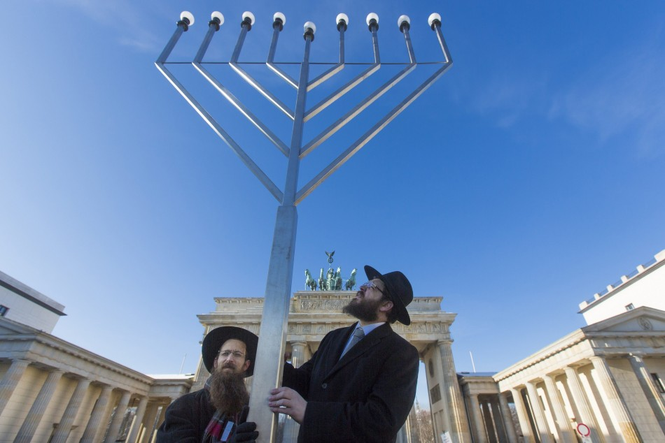 Rabbis Segal and Teichtal of Orthodox Jewish Chabad Lubawitsch community bless menorah after erecting it in front of Brandenburg Gate in Berlin ahead of Hanukkah celebrations