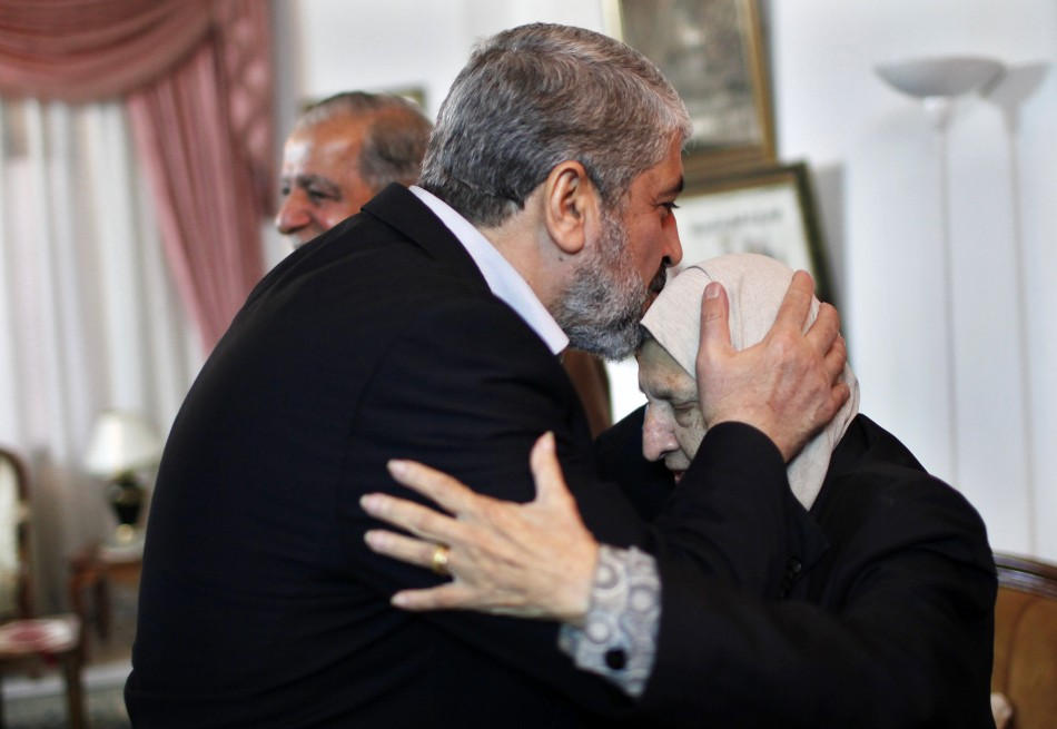 Hamas chief Meshaal kisses the head of Kadejah, the sister of late Palestinian leader Arafat, in Gaza