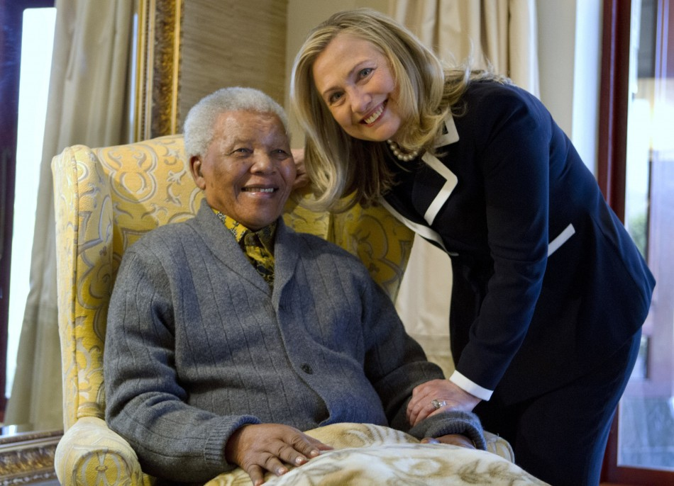 U.S. Secretary of State Hillary Rodham Clinton poses for a photograph with Nelson Mandela,