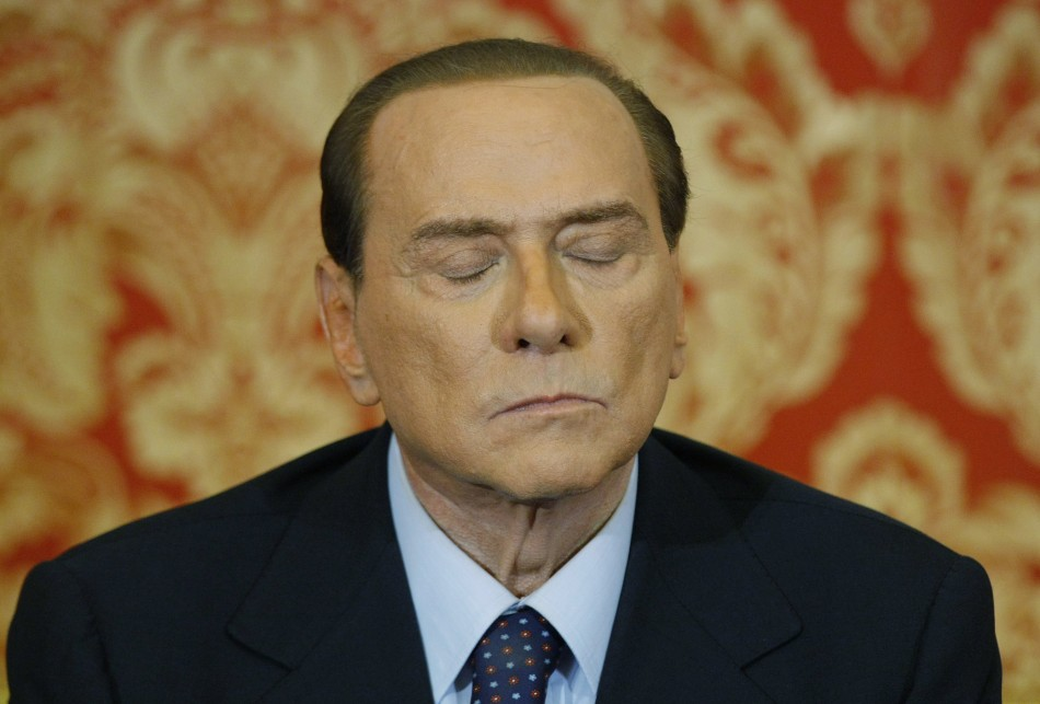 Italy's former Prime Minister Silvio Berlusconi listens during a news conference at Villa Gernetto in Gerno near Milan