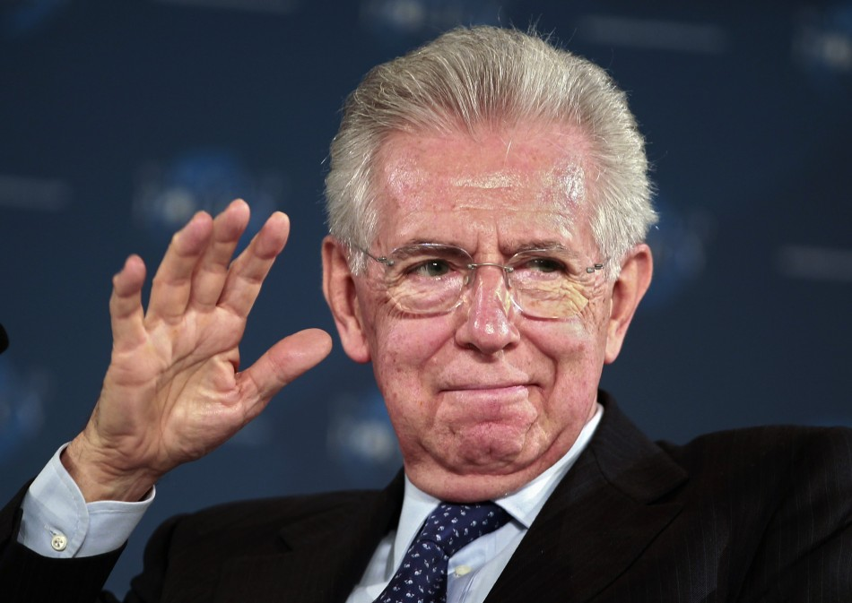 Italy's Prime Minister Monti gestures at the World Policy Conference in Cannes
