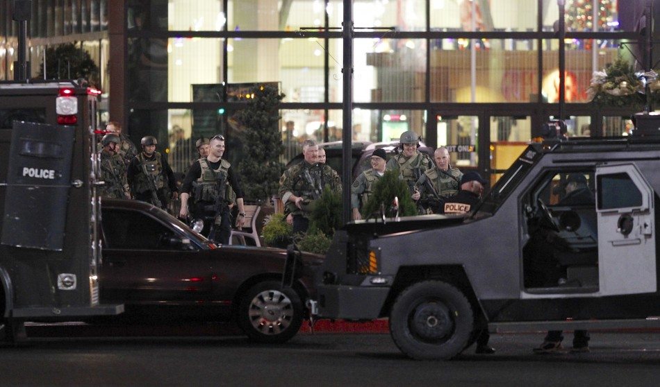 Police exit the Clackamas Town Center shopping mall in Portland (Reuters)