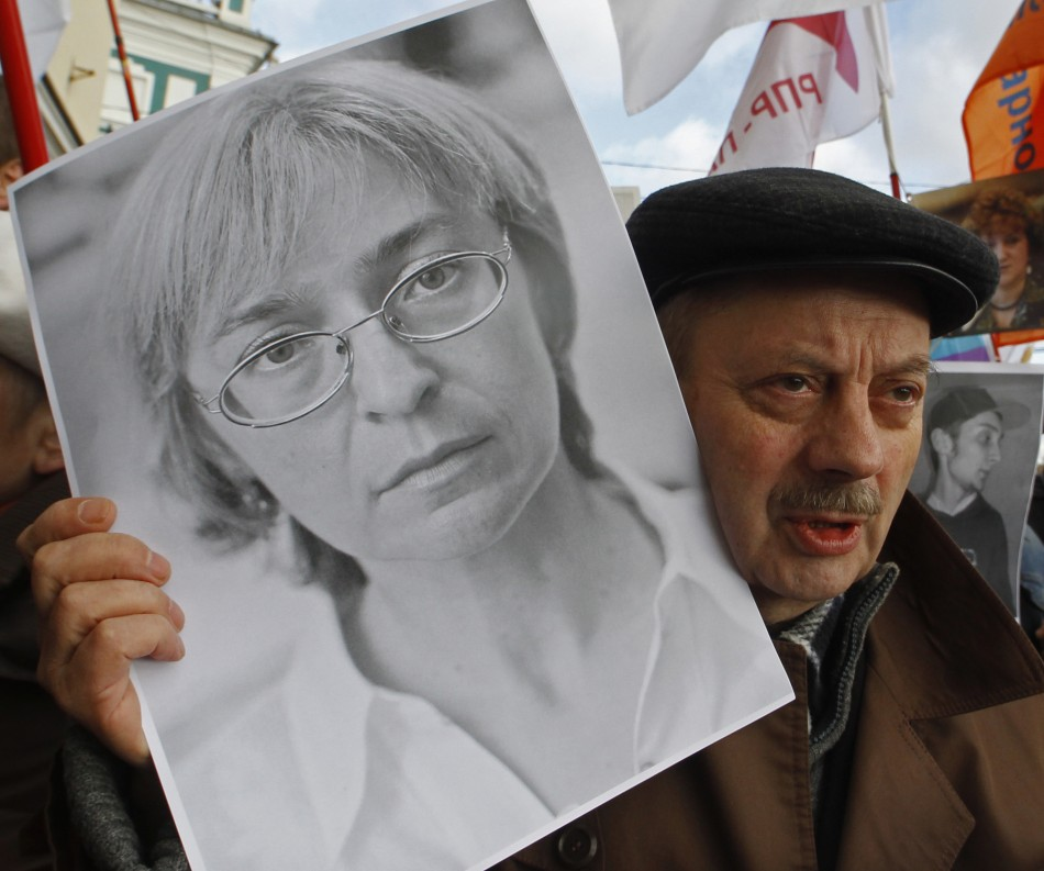 A participant holds a portrait of assassinated human rights activist Politkovskaya during a
