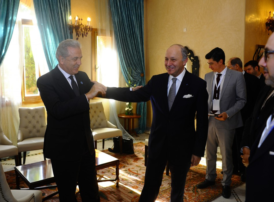 Saudi Arabia's Foreign Minister Saud speaks with his French counterpart Fabius after a
