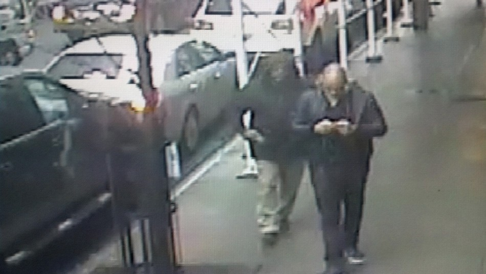 A video still image of a gunman pulling a weapon behind Brandon Lincoln Woodard in New York