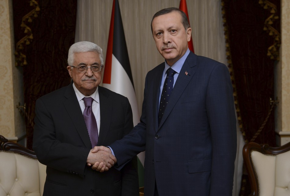 Palestinian President Abbas shakes hands with Turkey's Prime Minister Erdogan during their meeting in Ankara