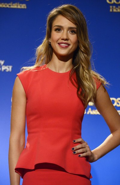 Actress Alba poses for photographers at the announcement of nominations for the 70th annual Golden Globe Awards in Beverly Hills