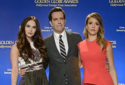 Actresses Fox and Alba pose for photographers with actor Helms at the announcement of nominations for the 70th annual Golden Globe Awards in Beverly Hills