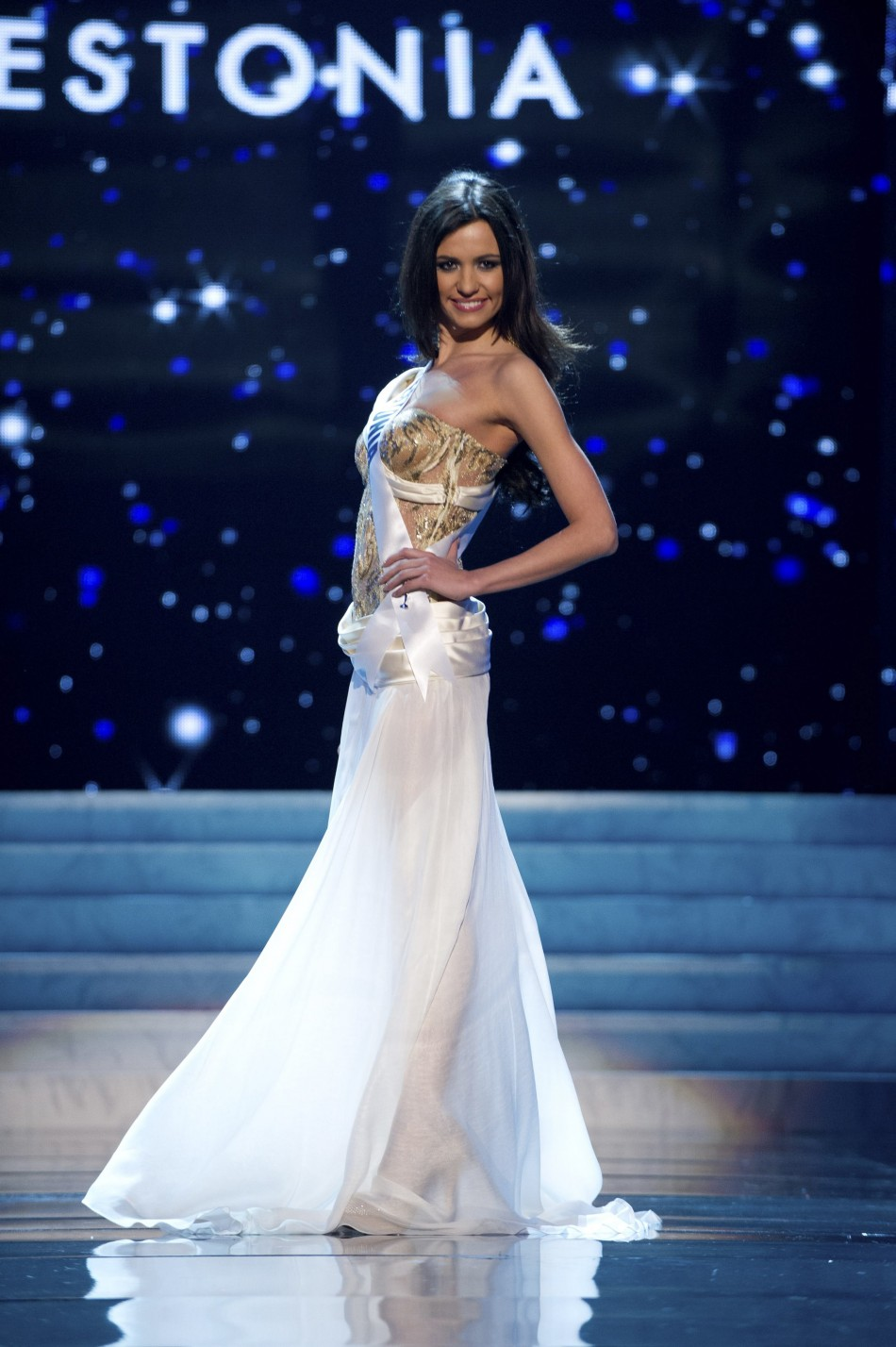 Miss Estonia 2012 Korneitsik competes in an evening gown of her choice during the Evening Gown Competition of the 2012 Miss Universe Presentation Show in Las Vegas