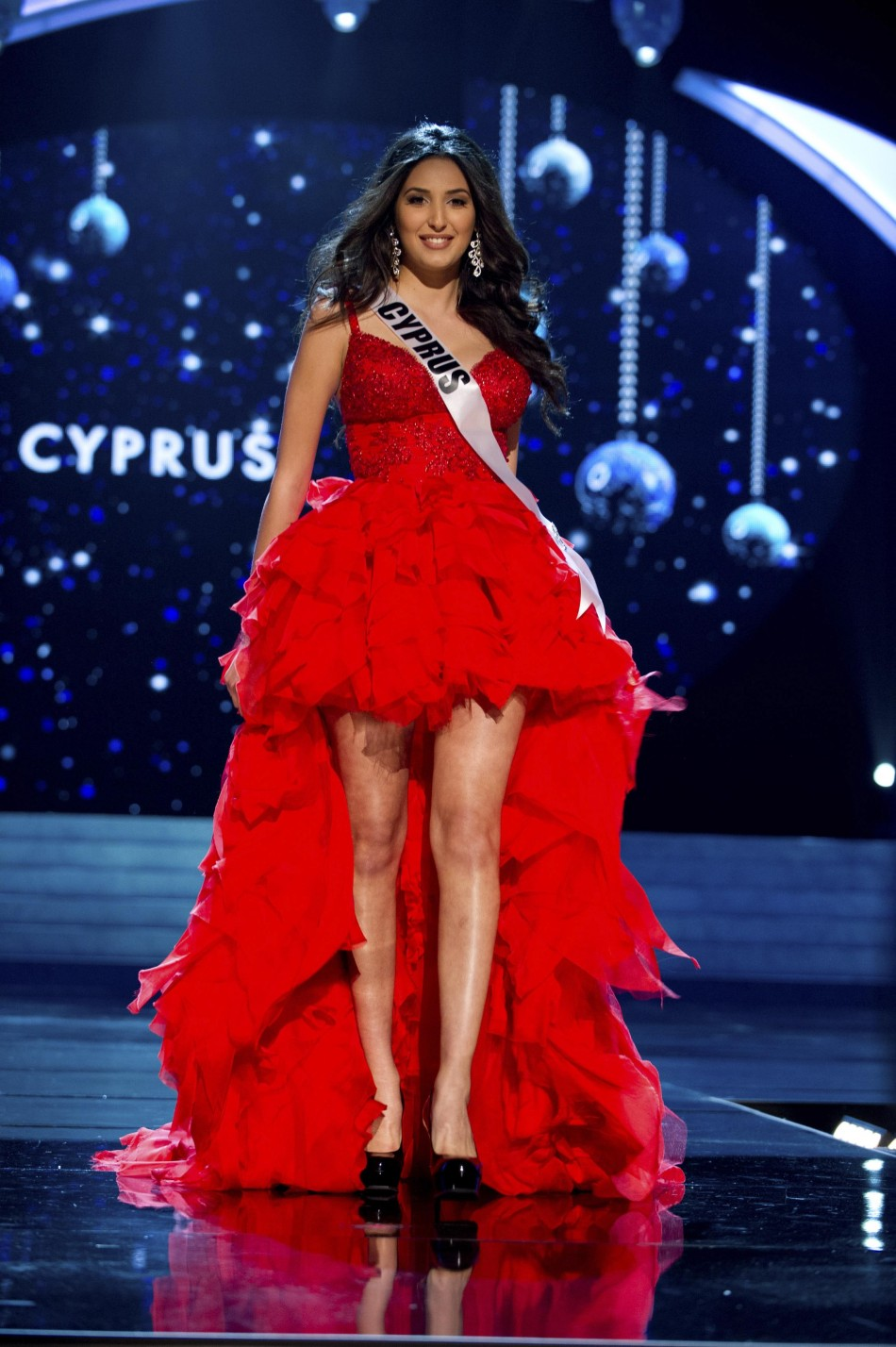 Miss Cyprus 2012 Yiannakou competes in an evening gown of her choice during the Evening Gown Competition of the 2012 Miss Universe Presentation Show in Las Vegas