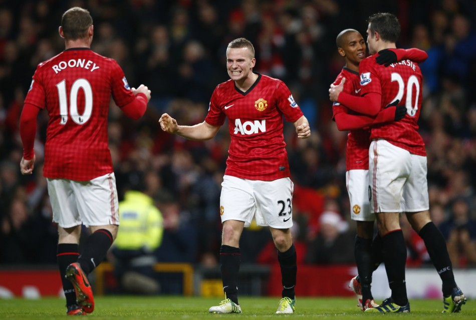 Wayne Rooney and Tom Cleverley (R)