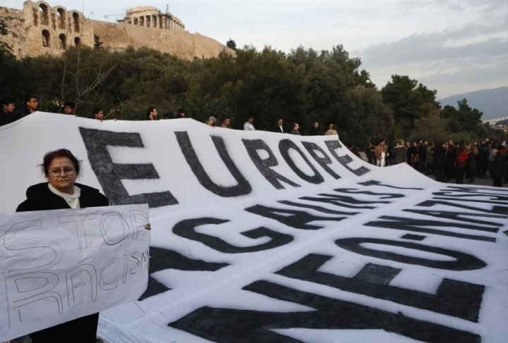 Protesters from across Europe hold a huge banner during a rally against the increase of racist attacks in Greece