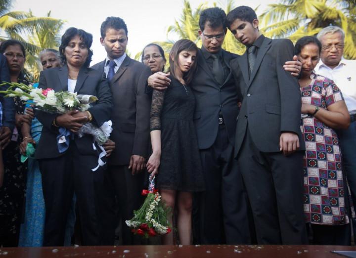 Jacintha Saldhanha's husband Ben Barboza conforts children Lisha and Junal