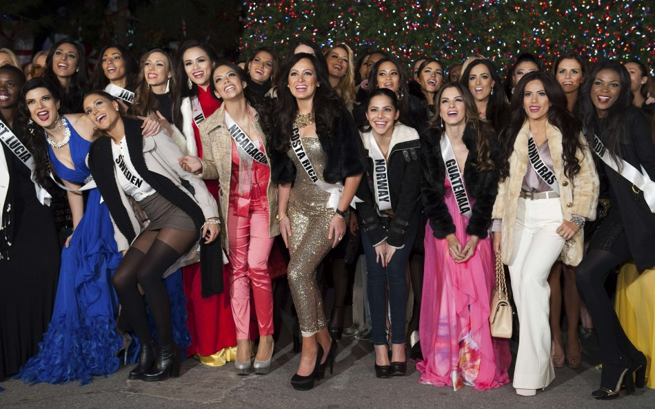 Miss Universe contestants pose during the Miss Universe National Gift Auction in Las Vegas