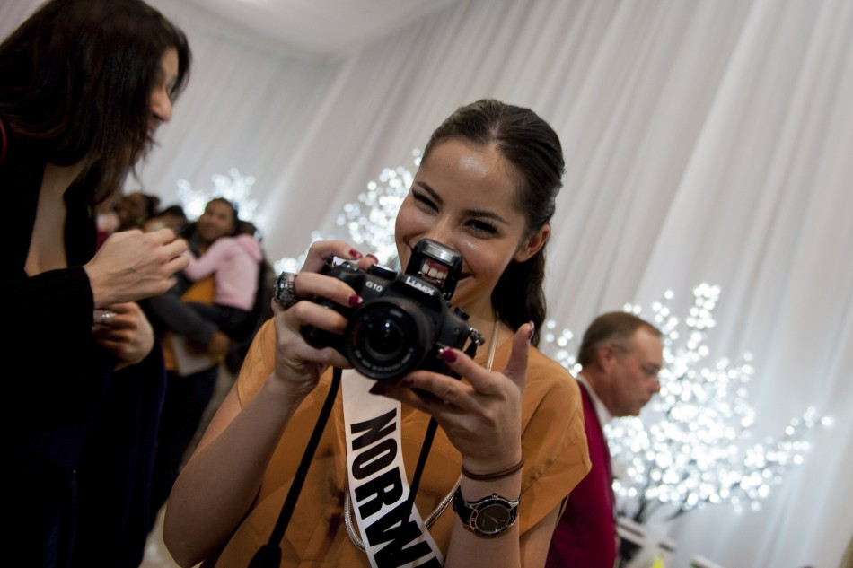 Miss Norway Andersen poses with a camera during the Miss Universe National Gift Auction in Las Vegas