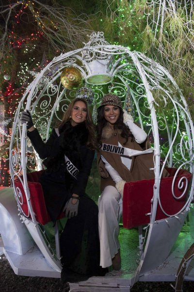Miss Colombia Vasquez and Miss Bolivia Mouton pose during the Miss Universe National Gift Auction in Las Vegas