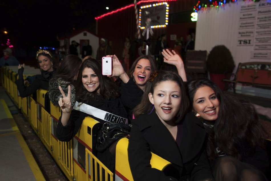 Miss Cyprus Yiannakou, Miss Mexico Gonzalez, Miss Guatemala Godoy and Miss Venezuela Quintero pose in a train during the Miss Universe National Gift Auction in Las Vegas
