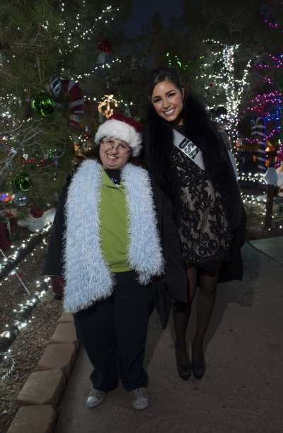 Miss USA Culpo poses with her Best Buddy during the Miss Universe National Gift Auction in Las Vegas