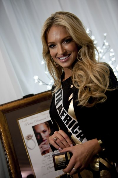 Miss South Africa Bam poses with her gift during the Miss Universe National Gift Auction in Las Vegas