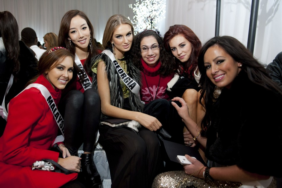 Miss Malaysia Leggett, Miss Korea Lee, Miss Georgia Shedania, Miss Germany Endemann and Miss Costa Rica Cascante pose with one of the Best Buddies during the Miss Universe National Gift Auction in Las Vegas