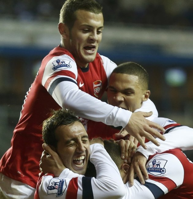 Cazorla celebrating his hat-trick with Wilshere, Gibbs and Podolski