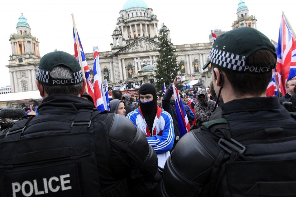 Protestors wave Union Flags and block the road in front of Belfast City Hall (Reuter