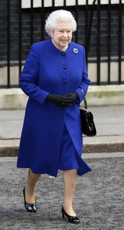 Queen walking alone