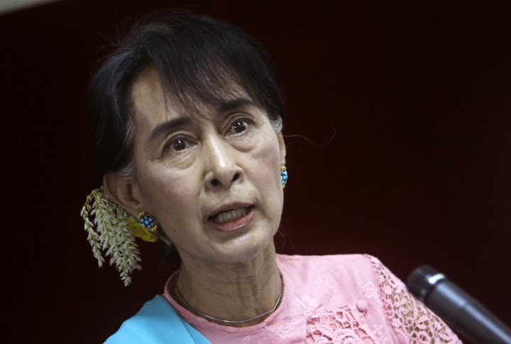 Myanmar pro-democracy Leader Aung San Suu Kyi talks to reporters during a news conference in Yangon