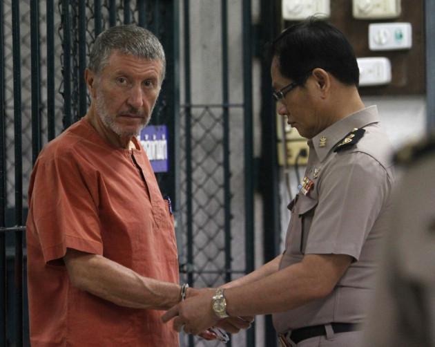 Italian suspect Vito Roberto Palazzolo, 65, is handcuffed near a prison cell at the criminal court in Bangkok