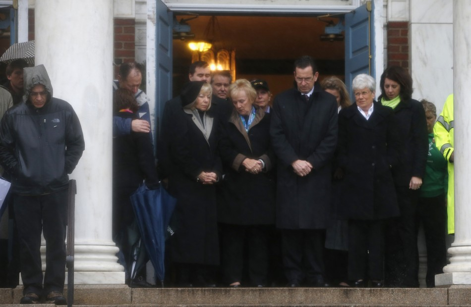 Connecticut Governor Daniel Malloy stands with others on the steps of the Edmond Town Hall during a moment of silence in Newtown (Reuters)