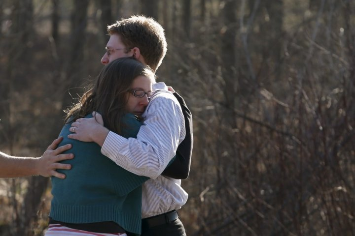 Sandy Hook: Shocked parents comfort each other after the massacre