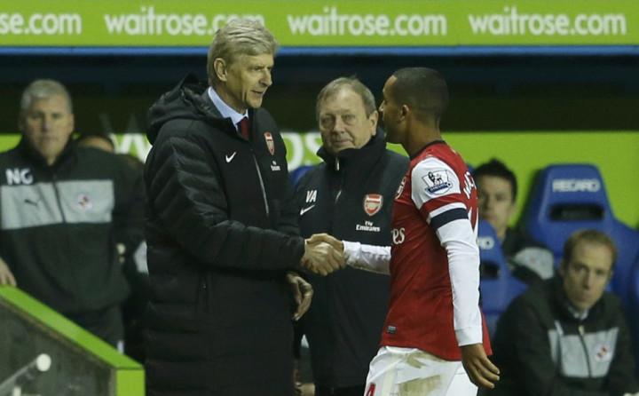 Arsene Wenger (L) and Theo Walcott