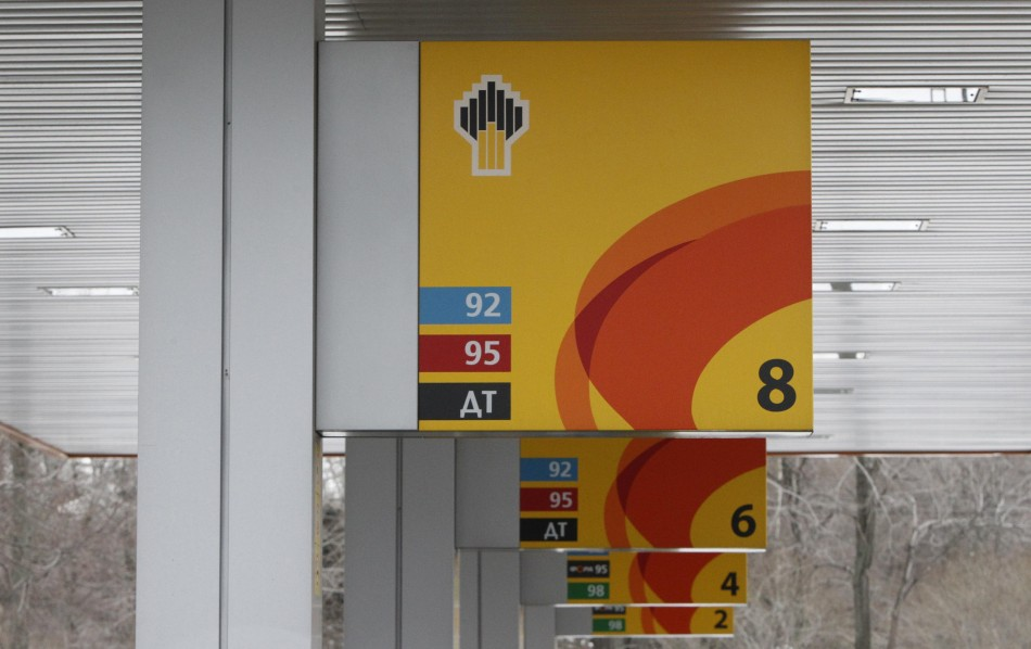 Company signage is seen on petrol pumps at a Rosneft filling station