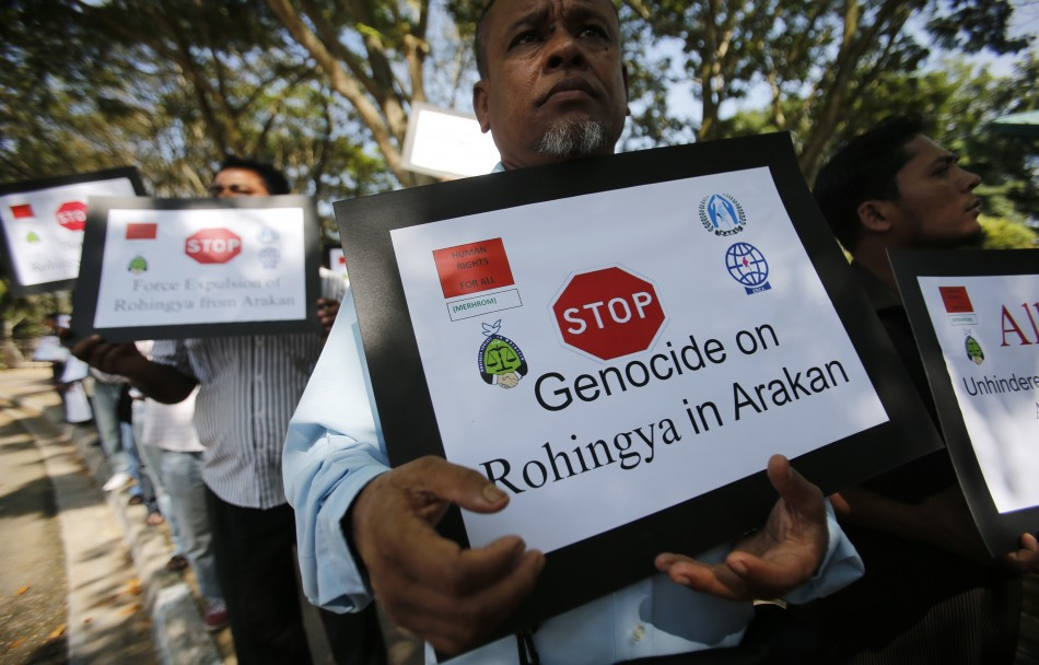 Myanmar people of Rohingya ethnicity who are living in Malaysia, display placards during a rally