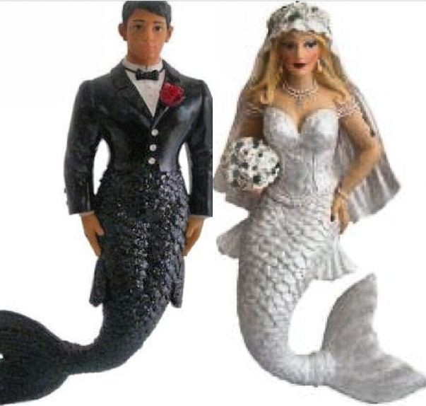 Hef is very supportive of my love of mermaids. Our toppers worked out perfectly Harris tweeted.