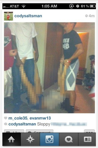 Steubenville football players carrying the alleged rape victim