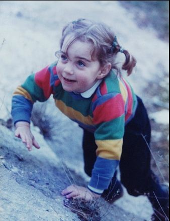 A rare photograph of Kate as a little girl, scrambling up and down grassy slopes... without a care in the world.