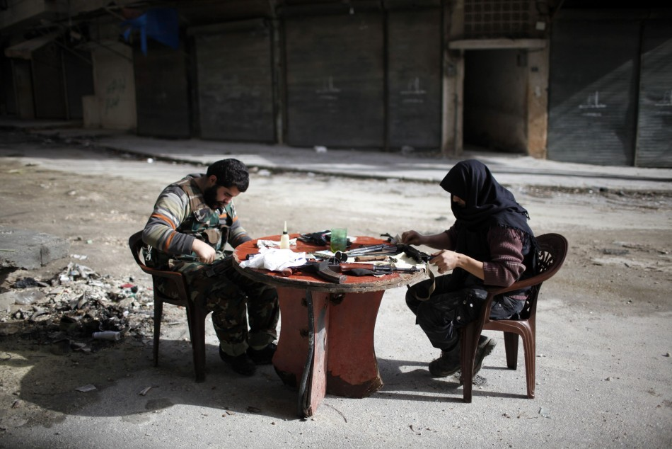 Fighters from the Islamist Syrian rebel group Jabhat al-Nusra clean their weapons in Aleppo