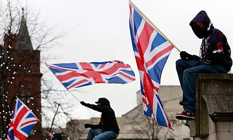 Protestors wave union flags in front of Belfast City Hall (Reuters)