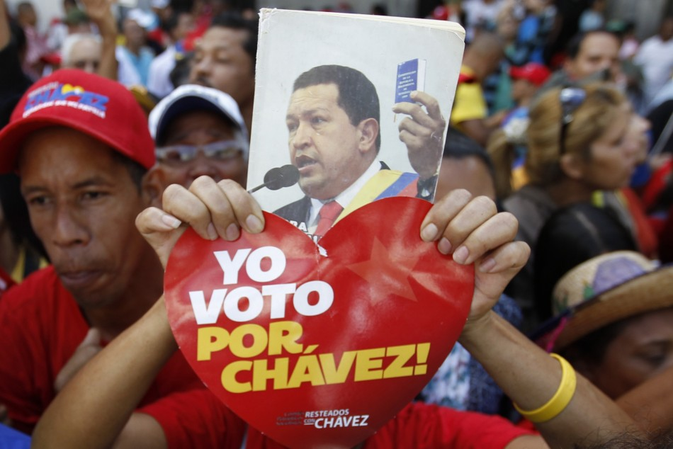 A supporter of Venezuela's President Chavez holds up a picture of him during the inauguration of the National Assembly in Caracas