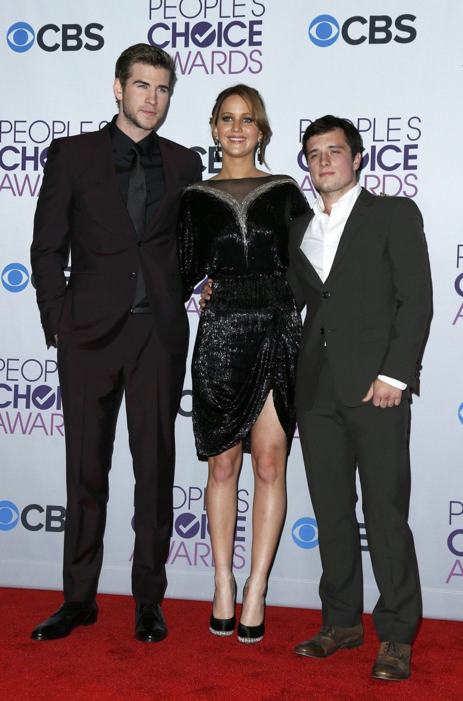 Hemsworth, Lawrence and Hutcherson of The Hunger Games pose backstage at the 2013 Peoples Choice Awards in Los Angeles
