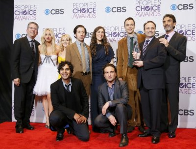 The cast and producers of The Big Bang Theory pose backstage after winning the award for favorite network tv comedy at the 2013 Peoples Choice Awards in Los Angeles
