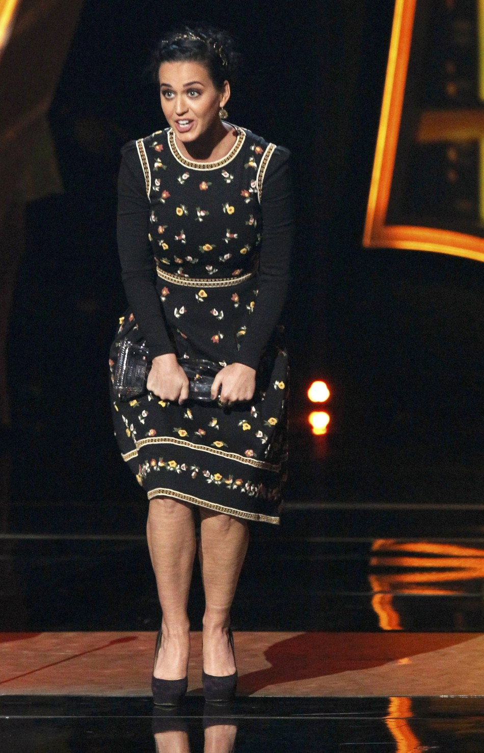 Katy Perry reacts after accepting the Favorite Pop Artist award at the 2013 Peoples Choice Awards in Los Angeles
