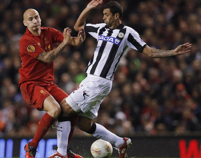 Danilo clatters Liverpool's Shelvey during Europa Cup tie