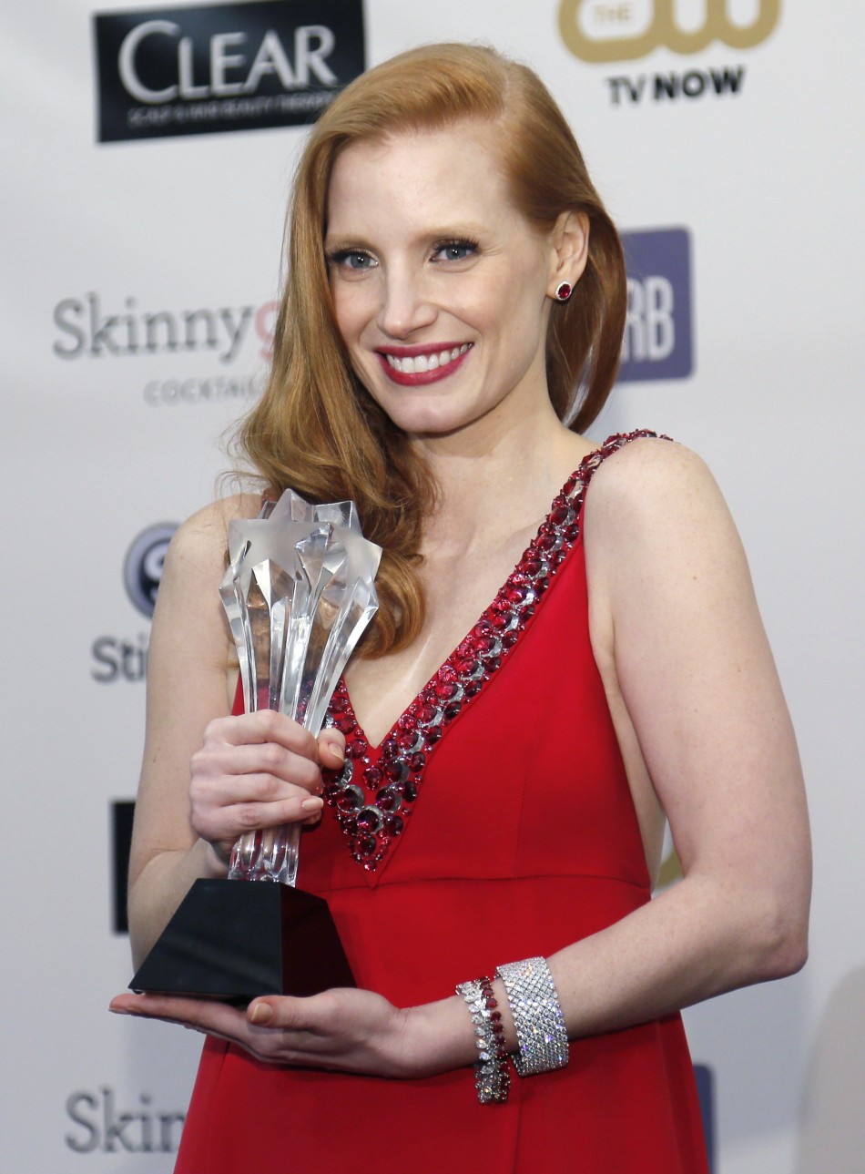 Jessica Chastain poses with the best actress award backstage that she won for her role in Zero Dark Thirty at the 2013 Critics Choice Awards in California