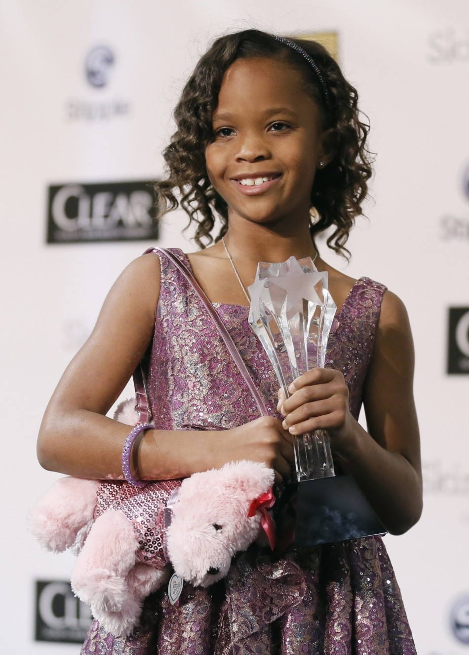 Quvenzhane Wallis accepts the award for Best Young ActorActress for her role in Beasts of the Southern Wild at the 2013 Critics Choice Awards in Santa Monica