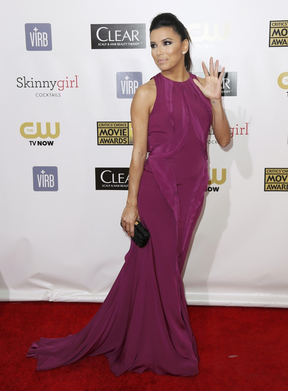 Actress Eva Longoria poses on arrival at the 2013 Critics' Choice Awards in Santa Monica